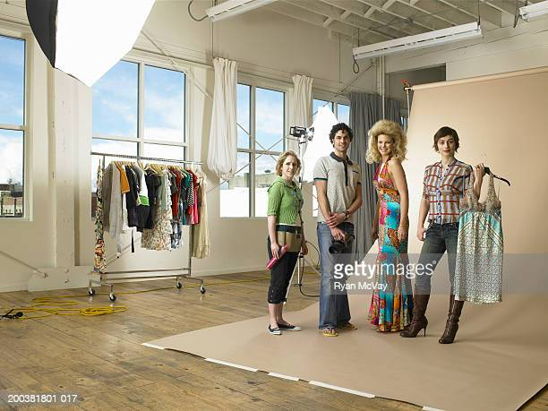 Stylists, model and photographer on set at photo shoot, portrait