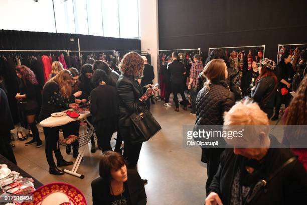 Stylists prepare backstage for Naeem Khan during New York Fashion Week The Shows at Gallery I at Spring Studios on February 13 2018 in New York City