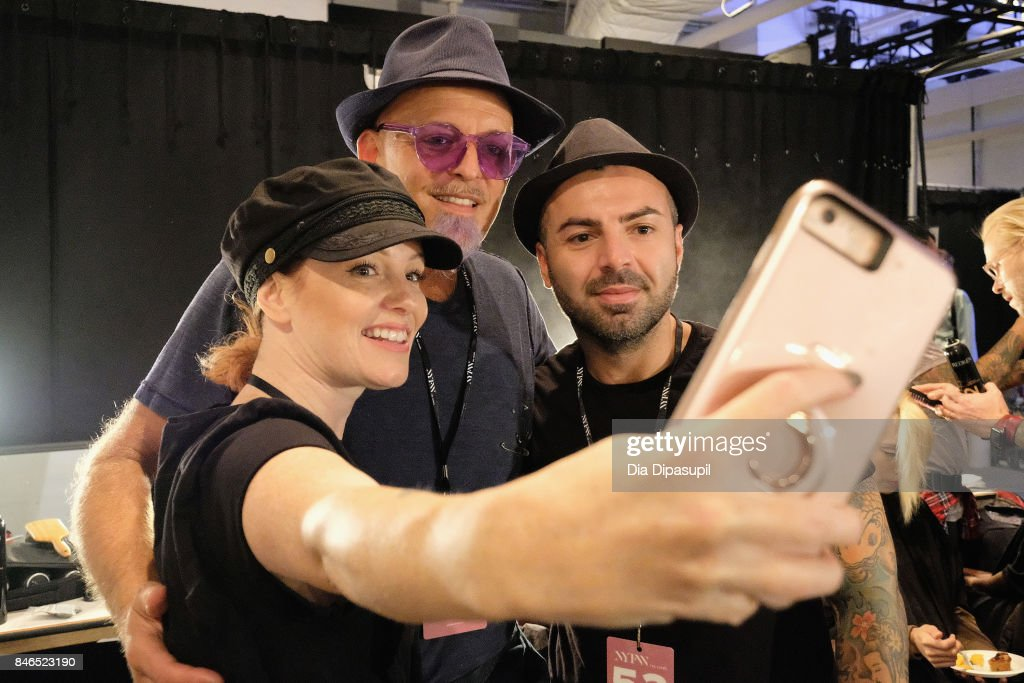 Stylists take a selfie backstage for the Chocheng fashion show during New York Fashion Week: The Shows at Gallery 3, Skylight Clarkson Sq on September 13, 2017 in New York City.