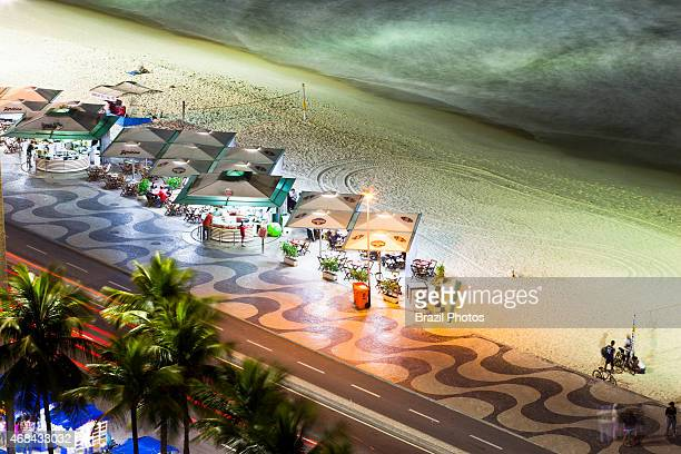 Stylized and standardized Kiosks with restaurants and bars at Copacabana beach sidewalk view from above of Copacabana promenade a pavement landscape...