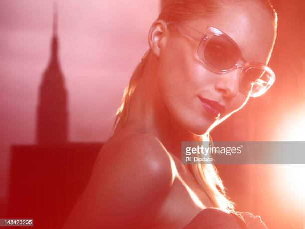 stylized image of blonde in sunglasses