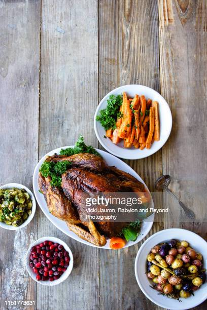 stylized image of turkey dinner with vegetables on rustic table - turkey meat stock pictures, royalty-free photos & images