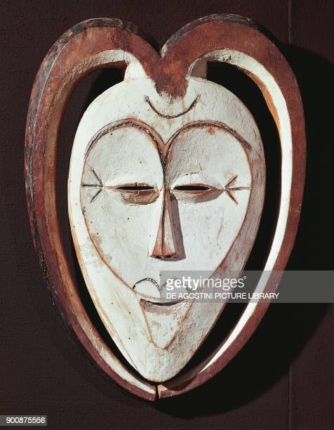 Stylized mask of a white and brown male face, painted wood, Kwele population, Zaire, Africa, 20th century.