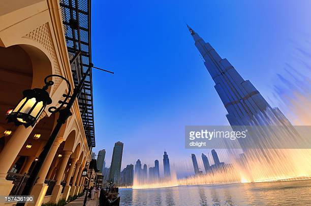 stylized shot of the musical fountain in dubai - fountain stock pictures, royalty-free photos & images