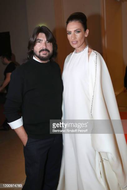 Styllist Stephane Rolland and his Model Nieves Alvarez pose prior the Stephane Rolland Haute Couture Spring/Summer 2020 show as part of Paris Fashion...