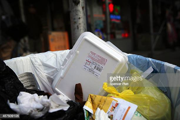 A styrofoam takeout container is viewed in a trash can on December 19 2013 in New York City New York's City Council will vote Thursday on a bill that...