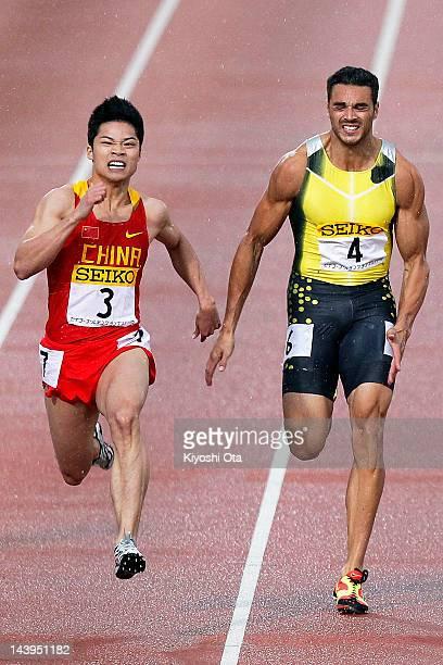 Su Bingtian of China and Joshua Ross of Australia compete in the Men's 100m during the Seiko Golden Grand Prix Kawasaki at Todoroki Stadium on May 6...