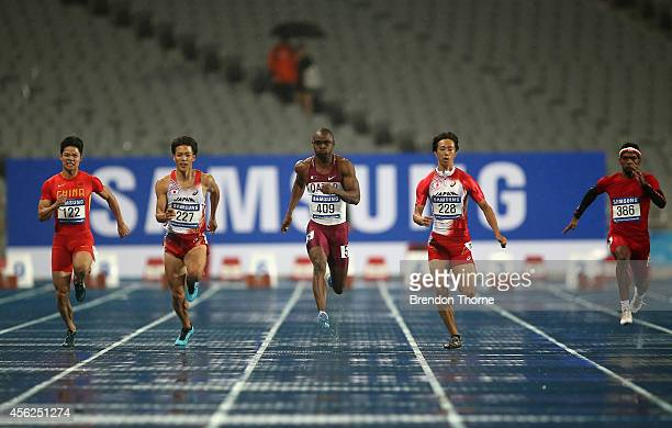 Su Bingtian of China Ryota Yamagata of Japan Femi Seun Ogunode of Qatar Kei Takase of Japan and Barakat Mubarak Mabrook Harthi of Oman compete in the...
