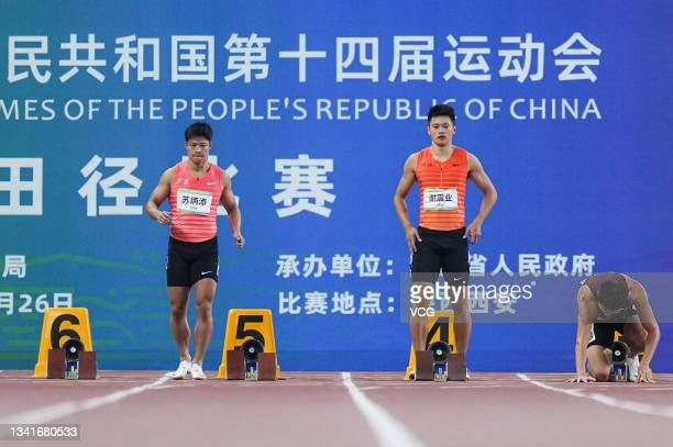 Su Bingtian of Guangdong and Xie Zhenye of Zhejiang compete in the Men's 100m Sprint Final during China's 14th National Games at Xi'an Olympic Center...