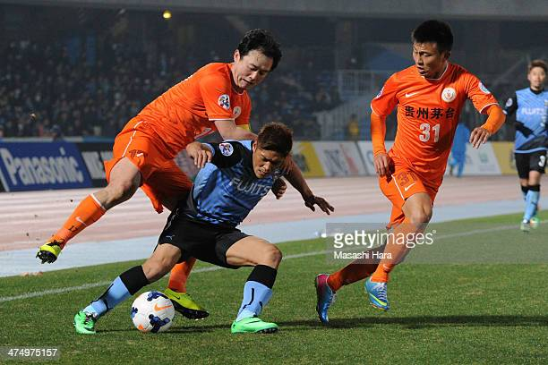 Su Jihai of Guizhou Renhe and Yoshito Okubo of Kawasaki Frontale compete for the ball during the match between Kawasaki Frontale and Guizhou Renhe on...