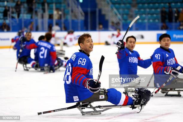 Su Min Han of Korea celebrates after the Ice Hockey Preliminary Round Group B game between South Korea and Japan during during day one of the...