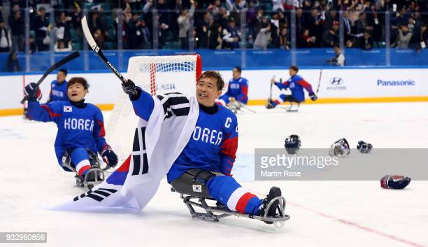 Su Min Han of Korea celebrates after winning the bronze medal over Italy in the Ice Hockey bronze medal game between Korea and Italy during day eight...