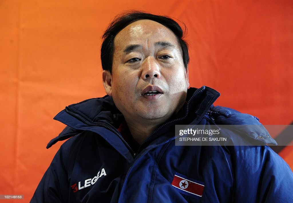 Su Myong Jang, North Korea media officer answers journalists during a press conference at Makhulong Stadium on June 16, 2010 in Tembisa, South Africa.