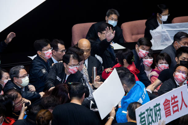TWN: Protest Break Out In Taiwan Parliament Against U.S. Pork Imports - KMT Throws Pig Offal On The Podium