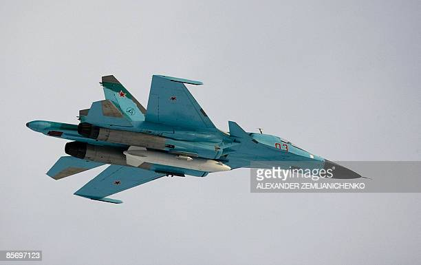 A Su34 bomber jet with Russian President Dmitry Medvedev aboard flies over the Kubinka airfield near Moscow in Kubinka on March 28 2009 The white...