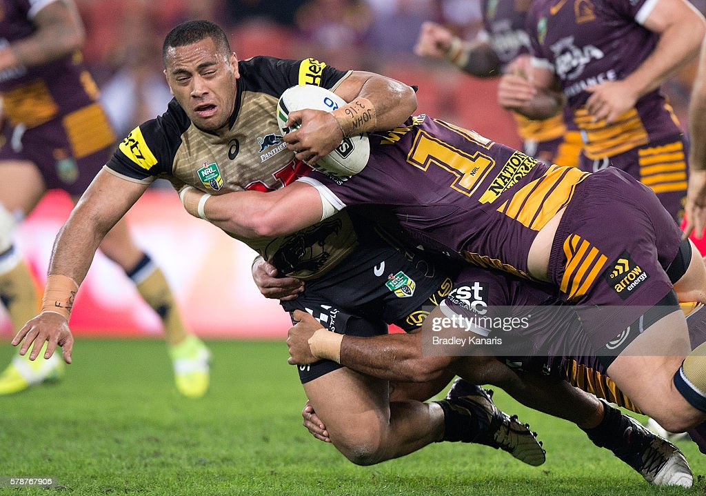 Suaia Matagi of the Panthers is tackled during the round 20 NRL match between the Brisbane Broncos and the Penrith Panthers at Suncorp Stadium on July 22, 2016 in Brisbane, Australia.