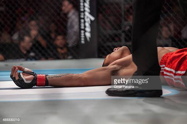 Suasday Chau lays on the floor after being illegally hit by his opponent Arnaud Lepont during One FC Cambodia on September 12 2014 in Phnom Penh...