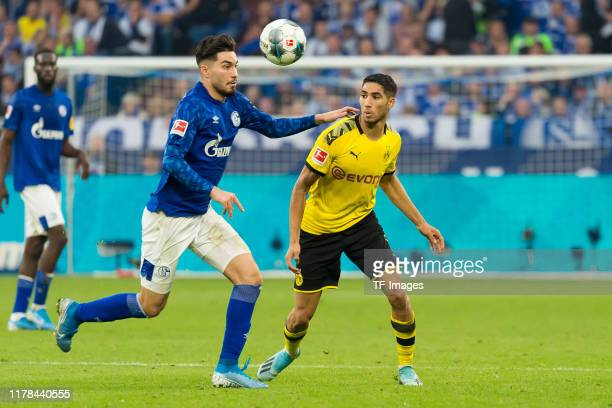 Suat Serdar of FC Schalke 04 and Achraf Hakimi of Borussia Dortmund battle for the ball during the Bundesliga match between FC Schalke 04 and...