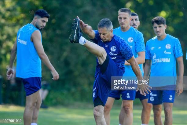 Suat Serdar of FC Schalke 04, Athletic coach Werner Leuthard of FC Schalke 04 and Bastian Oczipka of FC Schalke 04 looks on during the FC Schalke 04...