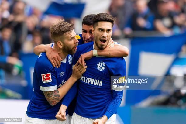 Suat Serdar of FC Schalke 04 celebrates after scoring his team's first goal with Guido Burgstaller of FC Schalke 04 and Nassim Boujellab of FC...