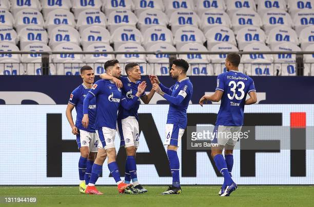 Suat Serdar of FC Schalke 04 celebrates with team mates after scoring their side's first goal during the Bundesliga match between FC Schalke 04 and...