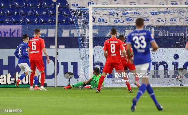 Suat Serdar of FC Schalke 04 scores their side's first goal past Rafal Gikiewicz of FC Augsburg during the Bundesliga match between FC Schalke 04 and...