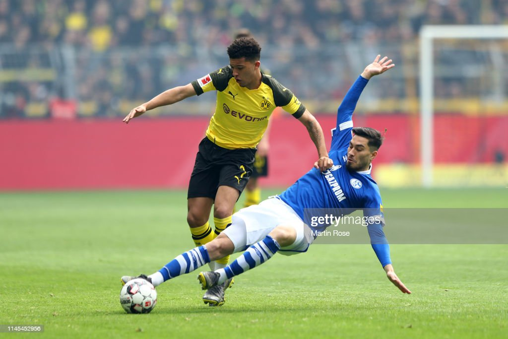 Suat Serdar Of Fc Schalke 04 Tackles Jadon Sancho Of Borussia News Photo Getty Images
