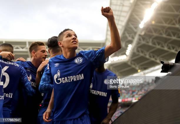 Suat Serdar of FC Schalke shoots celebrates Amine Harit of FC Schalke 04 goal during the Bundesliga match between RB Leipzig and FC Schalke 04 at Red...