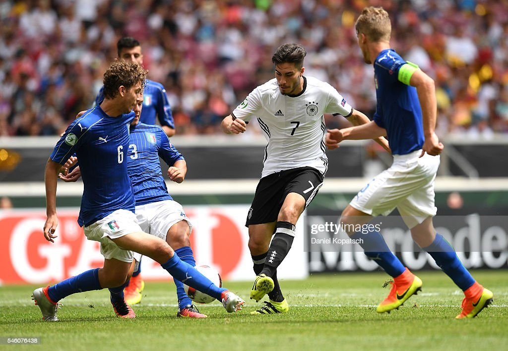 Suat Serdar of Germany (C) shoots during the UEFA Under19 European Championship match between U19 Germany and U19 Italy at Mercedes-Benz Arena on July 11, 2016 in Stuttgart, Germany.