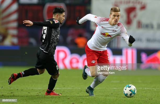 Suat Serdar of Mainz battles for the ball with Marcel Halstenberg of Leipzig during the Bundesliga match between RB Leipzig and 1FSV Mainz 05 at Red...
