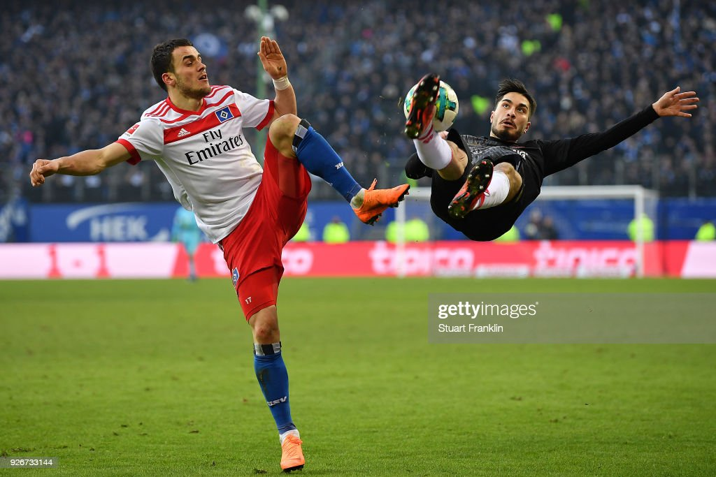 Suat Serdar of Mainz (r) fights for the ball with Filip Kostic of Hamburg during the Bundesliga match between Hamburger SV and 1. FSV Mainz 05 at Volksparkstadion on March 3, 2018 in Hamburg, Germany.