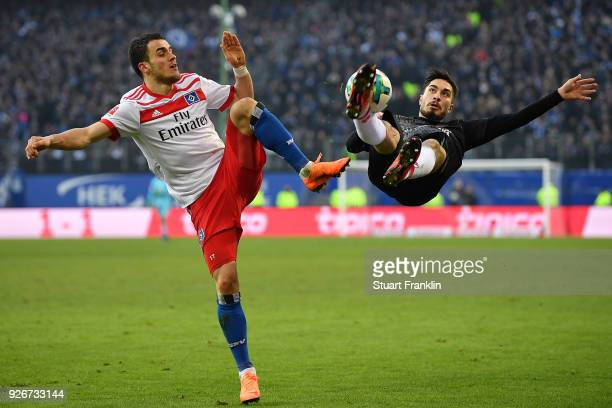 Suat Serdar of Mainz fights for the ball with Filip Kostic of Hamburg during the Bundesliga match between Hamburger SV and 1 FSV Mainz 05 at...