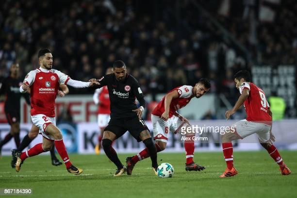Suat Serdar of Mainz KevinPrince Boateng of Frankfurt Danny Latza and Yoshinori Muto of Mainz battle for the ball during the Bundesliga match between...