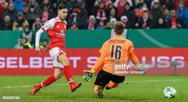 Suat Serdar of Mainz scores the third goal for his team against RonRobert Zieler of Stuttgart during the DFB Cup match between 1 FSV Mainz 05 and VfB...