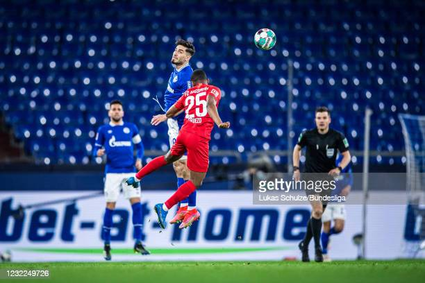 Suat Serdar of Schalke and Carlos Gruezo of Augsburg in action during the Bundesliga match between FC Schalke 04 and FC Augsburg at Veltins-Arena on...