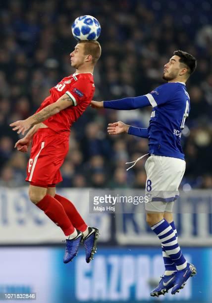 Suat Serdar of Schalke challenges Dmitri Barinov of Moscow during the UEFA Champions League Group D match between FC Schalke 04 and FC Lokomotiv...