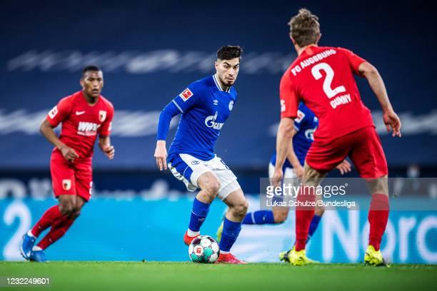 Suat Serdar of Schalke in action during the Bundesliga match between FC Schalke 04 and FC Augsburg at Veltins-Arena on April 11, 2021 in...