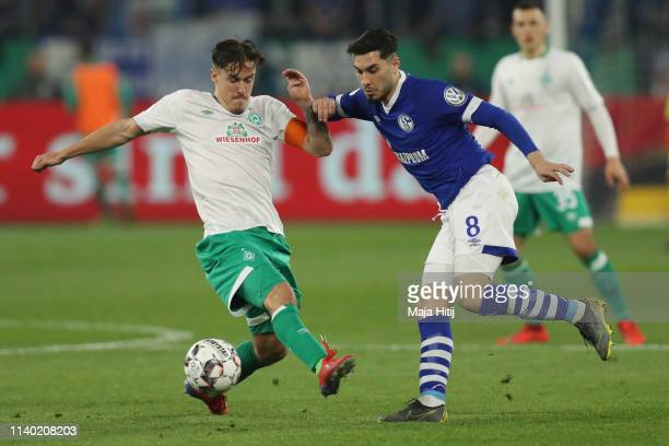 Suat Serdar of Schalke is challenged by Max Kruse of Bremen during the DFB Cup quarterfinal match between FC Schalke 04 and Werder Bremen at...