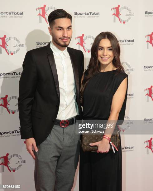 Suat Serdar poses with his girlfriend at the 10th anniversary celebration of the Sports Total Agency on November 5 2017 in Cologne Germany