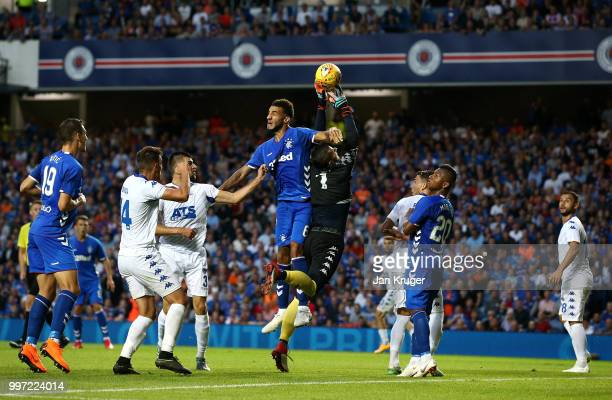 Suat Zendeli of FC Shkupi catches the ball under pressure from Connor Goldson of Rangers during the UEFA Europa League Qualifying Round match between...