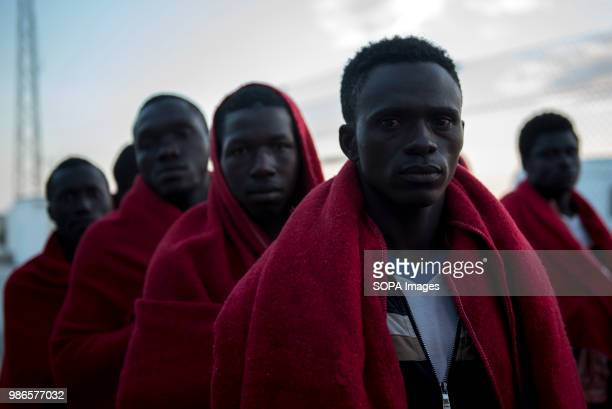 PORT MOTRIL GRANADA SPAIN Sub Saharan migrants waiting to be assisted by Red Cross at Motril port 58 people were rescued in Alboran Sea from a dinghy...