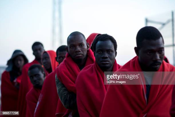 PORT MOTRIL GRANADA SPAIN Sub Saharan migrants waiting to be registered and assisted by Red Cross at Motril port 58 people were rescued in Alboran...
