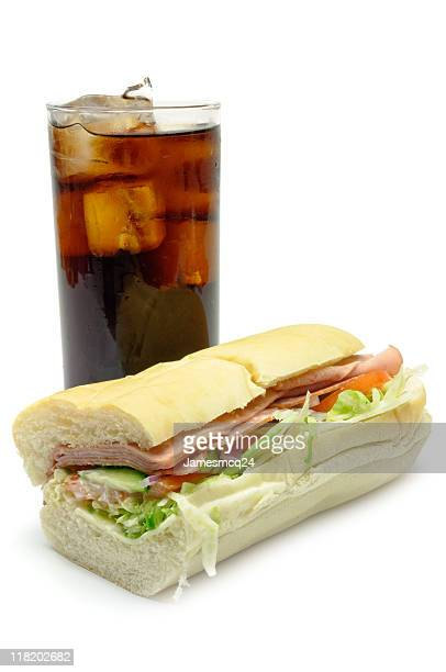 sub sandwich and cola - baloney stock photos and pictures
