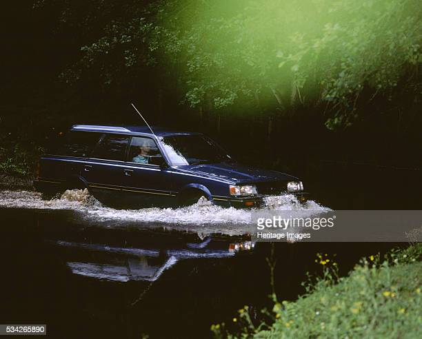 Subaru 18 4WD Estate driving through water 2000