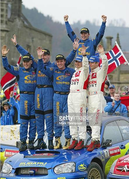Subaru's Kaj Lindstrom and Tommi Makinen 3rd place Phil Mills and Petter Solberg 1st place and Daniel Elena and Sebastien Loeb 2nd place celebrate...
