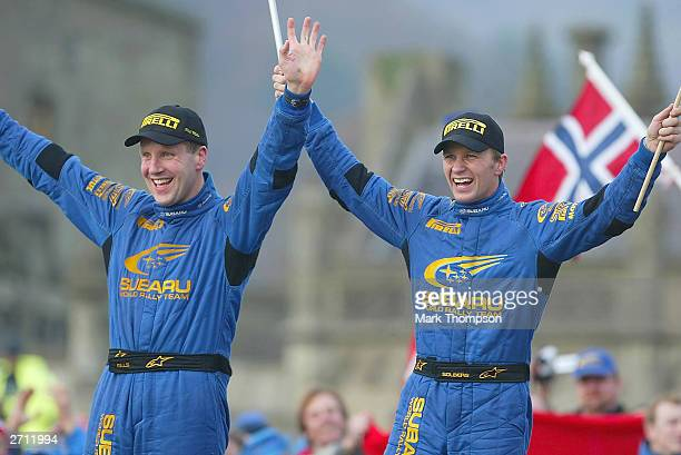 Subaru's Phil Mills and Petter Solberg celebrate after winning the World Rally Champiosnip and the Wales Rally GB at Margam Park on November 9 2003...