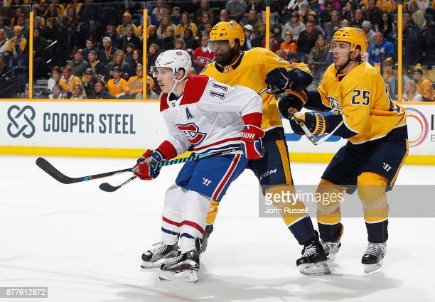 K Subban and Alexei Emelin of the Nashville Predators defend against Brendan Gallagher of the Montreal Canadiens during an NHL game at Bridgestone...