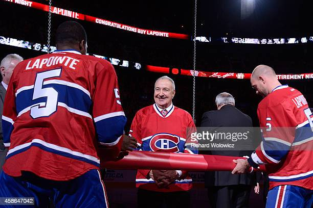 K Subban and Andrei Markov hang the banner that will be raised to the Bell Centre rafters during the jersey retirement ceremony for former Montreal...