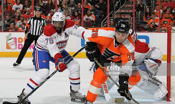 K Subban and Ben Scrivens of the Montreal Canadiens defend their goal against Chris VandeVelde of the Philadelphia Flyers on January 5 2016 at the...