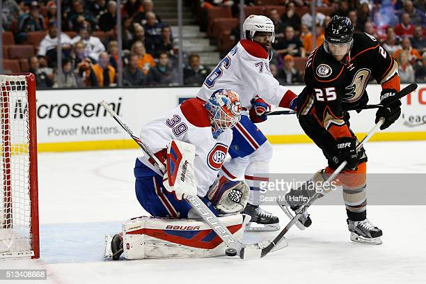 K Subban and Mike Condon of the Montreal Canadiens defend against the shot of Mike Santorelli of the Anaheim Ducks during the first period of a game...